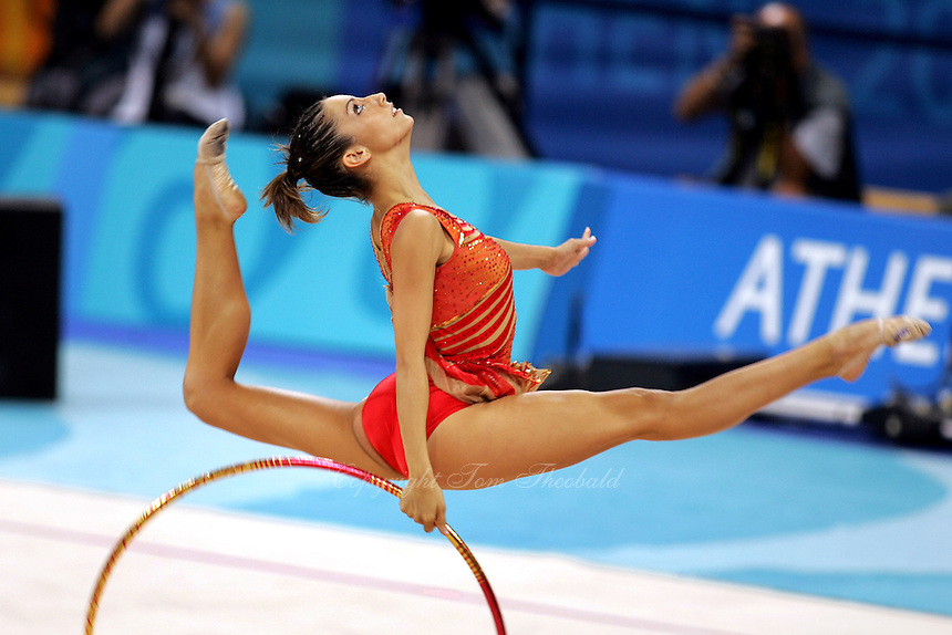 August 29, 2004; Athens, Greece; Rhythmic gymnastics star ALMUDENA CID of Spain split leaps with hoop in All-Around competition at 2004 Athens Olympics. Almudena Cid has made history by being the only rhythmic gymnast ever to make 3 Olympic finals.<br /> Copyright 2004 Tom Theobald