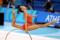 August 29, 2004; Athens, Greece; Rhythmic gymnastics star ALMUDENA CID of Spain split leaps with hoop in All-Around competition at 2004 Athens Olympics. Almudena Cid has made history by being the only rhythmic gymnast ever to make 3 Olympic finals.<br />