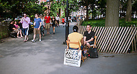 "Francisco offers free advise from his ""office"" in Washington Square Park on the Memorial Day holiday, Monday, May 28, 2012. Memorial Day is considered the unofficial start of summer!   (© Richard B. Levine)"