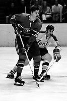 Montreal Canadien Pete Mahovlich and Seals Doug Roberts 1970 (photo by Ron Riesterer)