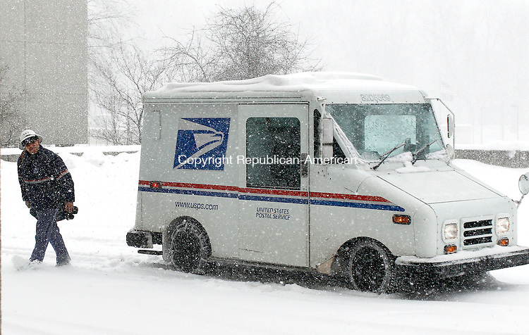 Naugatuck, CT- 04 February 2014-020214CM01- A U.S. postal worker delivers mail at the Naugatuck Town Hall on Thursday.  Despite towns and businesses shutting down, mail and delivery services were still out making their rounds amidst the storm.   Christopher Massa Republican-American