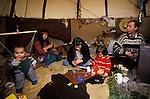 TeePee Valley near LLandeilo Wales UK. Hippy alternative Life style family living in a TeePee.<br /> <br /> Rev. Rick Mayes with Loki Mayes (in bouncer) Kim Green,Shanta Edwards, Kai Mayes,