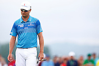 Zach Johnson waits to putt on the 18th green during the 2016 U.S. Open in Oakmont, Pennsylvania on June 16, 2016. (Photo by Jared Wickerham / DKPS)