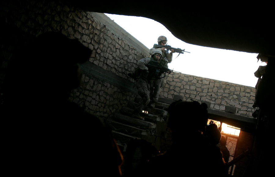 Marines from Golf Co. 2nd Battalion 1st Marines search for insurgents during the fifth day of Operation Steel Curtain, an operation to clear Husaybah (a city on the Iraq-Syrian border) of insurgents on Wed. 9, 2005.