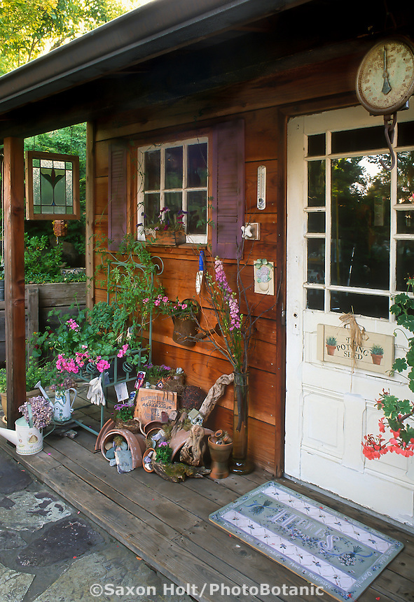 Garden tool potting shed porch with boardwalk floor decorated with recycled flea market style