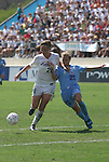 24 August 2003: Nancy Augustyniak (right) earns a red card for tackling Abby Wambach (28) at the edge of the penalty box four minutes into overtime. The Washington Freedom defeated the Atlanta Beat 2-1 in golden goal overtime to win the WUSA Founders Cup III championship game played at Torero Stadium in San Diego, CA.