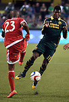 Jun 6, 2015; Portland, OR, USA; New England Revolution defender Jose Goncalves (23) and Portland Timbers midfielder/forward Dairon Asprilla (11) go after a ball during the second half of the game at Providence Park. The Timbers won the game 2-0. Mandatory Credit: Steve Dykes-USA TODAY Sports