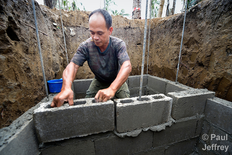 Efren Llegado constructs a septic tank in Bacubac, a seaside neighborhood in Basey in the Philippines province of Samar that was hit hard by Typhoon Haiyan in November 2013. The storm was known locally as Yolanda. Norwegian Church Aid, a member of the ACT Alliance, is sponsoring the construction of bathrooms with septic systems for houses in the village where existing systems were destroyed by the typhoon's unusually high storm surge.