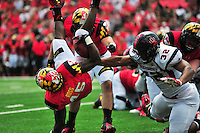 RB Brandon Ross of the Terrapins hits the ground hard after a tackle. Maryland defeated Richmond 50-21 during home season opener at the Byrd Stadium in College Park, MD on Saturday, September 5, 2015.  Alan P. Santos/DC Sports Box