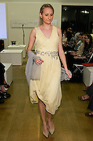 85 Broads member walks runway in a RC12 lemon yellow beaded dress by Yuna Yang, during the 85 Broads Presents Yuna Yang trunk show at Art Gate Gallery on October 24th 2011.