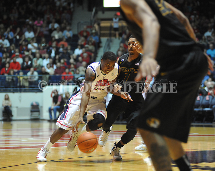 "Ole Miss' Jarvis Summers (32) vs. Missouri's Phil Pressey (1) at the C.M. ""Tad"" Smith Coliseum on Saturday, January 12, 2013. Ole Miss defeated #10 ranked Missouri 64-49."
