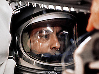 On May 5, 1961, astronaut Alan Shepard became the first American in space. He launched aboard his Mercury-Redstone 3, named Freedom 7, to make an historic 15-minute suborbital flight.<br /> <br /> This image shows Shepard in capsule before launch. After several delays and more than four hours in the capsule, Shepard was ready to go, and he famously urged mission controllers to 'fix your little problem and light this candle.'<br /> <br /> Image Credit: NASA
