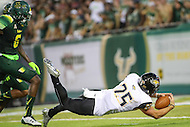Tampa, FL - September 2, 2016: Towson Tigers wide receiver Christian Summers (25) dives for the endzone during game between Towson and USF at the Raymond James Stadium in Tampa, FL. September 2, 2016.  (Photo by Elliott Brown/Media Images International)