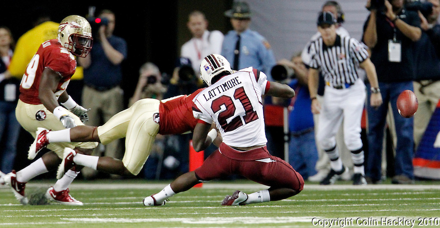 ATLANTA, AG 12/31/10-FSU-SC FB10 CH-Florida State's Greg Reid puts a punishing hit on South Carolina's Marcus Lattimore forcing a fumble during first quarter action Friday at the Chick-fil-A Bowl in Atlanta..COLIN HACKLEY PHOTO