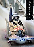 18 December 2010: Sandra Kiriasis celebrates victory as she crosses the finish line piloting her 2-man bobsled for Germany to the gold at the Viessmann FIBT World Cup Bobsled Championships on Mount Van Hoevenberg in Lake Placid, New York, USA. Mandatory Credit: Ed Wolfstein Photo