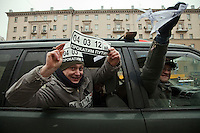 Moscow, Russia, 26/02/2012..Opposition protesters shout slogans from a car in a motorcade decorated with anti-Putin slogans. Tens of thousands of people formed a 16-kilometre [10-mile] human chain along Moscow's Garden Ring Road in the latest protest against Prime Minister Vladimir Putin and his presidential election campaign. Opposition activists estimated that they needed 34,000 people to complete the chain and symbolically encircle central Moscow.