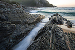 Jagged rocky shoreline at dawn, Tsitsikamma Marine Protected Area, Garden Route National Park, Eastern Cape, South Africa,