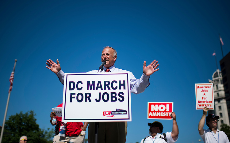 """UNITED STATES - JULY 15: Rep. Steve King, R-Iowa, speaks during the Black American Leadership Alliance's """"D.C. March for Jobs"""" rally at Freedom Plaza in Washington on Monday, July 15, 2013. The rally and march were held to call attention to the impact that illegal immigration has on wages, and lost employment opportunities for low-skilled Americans. (Photo By Bill Clark/CQ Roll Call)"""