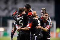 Branko Boskovic (8) of D.C. United is surrounded by teammates Dejan Jakovic (5), Andy Najar (14), and Perry Kitchen (23) after scoring the winning goal during the game at RFK Stadium in Washington, DC.  D.C. United defeated Chivas USA, 1-0.
