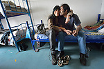 "Zeffie Papamichail and Yasir Nadeem sit in their room in the Krnjaca Center for Refugees on the outskirts of Belgrade, Serbia. The Greek-Pakistani couple is bound for western Europe, seeking work. ""Not Germany, there are too many people and no jobs,"" said Nadeem. ""We want to go where there is work. I hear England is good,"" said Papamichail."