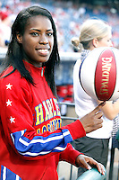 Pictured with the iconic red, white, and blue basketball in hand, Temple University alumna and current Harlem Globetrotters star Fatima 'TNT' Maddox took the mound to throw out the first pitch before the Philadelphia Phillies host the Milwaukee Brewers baseball game at Citizens Bank Park in Philadelphia, Pa on July 24, 2012 © Star Shooter / MediaPunchInc