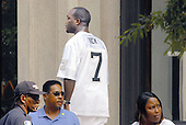 Richmond, VA - August 27, 2007 -- Michael Vick family friend, Wallace Green, wearing number 7 jersey, departs the U.S. District Court in Richmond, Virginia after Vick pleaded on federal charges related to dog fighting..Credit: Ron Sachs / CNP.(RESTRICTION: No New York Metro or other Newspapers within a 75 mile radius of New York City)