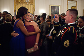First Lady Michelle Obama is photographed with a guest during the Department of Defense dinner in the East Room of the White House, February 29, 2012. The President and First Lady hosted the dinner to honor members of the Armed Forces who served in Operation Iraqi Freedom and Operation New Dawn, and to honor their families. .Mandatory Credit: Pete Souza - White House via CNP
