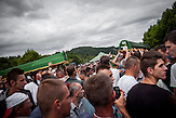 Coffins with the human remains of two newly identified victims of the 1995 Srebrenica massacre are carried to their resting place.