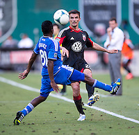 Alain Rochat (25) of D.C. United lifts the ball over Marvin Chavez (81) of the San Jose Earthquakes during a Major League Soccer game at RFK Stadium in Washington, DC.  D.C. United defeated San Jose Earthquakes, 1-0.