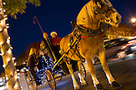 A guest climbs aboard a horse-drawn carriage for a short ride around town.