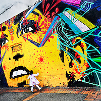 A Colombian baby girl jumps in front of a graffiti artwork, created by artists named Stinkfish & Zas, in La Candelaria, Bogotá, Colombia, 18 February, 2016. A social environment full of violence and inequality (making the street art an authentic form of expression), with a surprisingly liberal approach to the street art from Bogotá authorities, have given a rise to one of the most exciting and unique urban art scenes in the world. While it's technically not illegal to scrawl on Bogotá's walls, artists may take their time and paint in broad daylight, covering the walls of Bogotá not only in territory tags and primitive scrawls but in large, elaborate artworks with strong artistic style and concept. Bogotá has become an open-air gallery of contemporary street art.