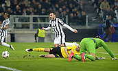 24.02.2015. Turin, Italy. EUFA Champions League football. Juventus versus Borussia Dortmand.  Sokratis and goalie Roman Weidenfeller (Dortmund) look disappointed as they go down 1-0 to a Tevez goal