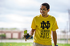 May 13, 2014; Junior Michael Martinez works on a service project at The Unity Garden in South Bend during senior week 2014.  The departing junior class helps arrange the service projects for the graduating seniors.<br /> <br /> Photo by Matt Cashore/University of Notre Dame