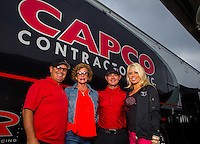Sept. 1, 2014; Clermont, IN, USA; Billy Torrence (left) with his wife Kay Torrence and son NHRA top fuel dragster driver Steve Torrence and his girlfriend during the US Nationals at Lucas Oil Raceway. Mandatory Credit: Mark J. Rebilas-USA TODAY Sports