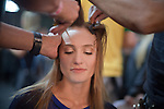 Model Lovani Pinnow gets her make-up done backstage for the Brazilian brand, Colcci, at São Paulo Fashion Week for Summer Season 2013/2014, at Bienal, in Ibirapuera Park, São Paulo, Brazil, on Thursday, March 21, 2013.