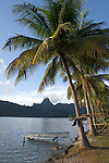 Cook's Bay, Moorea, French Polynesia; sunrise views of Cook's Bay with local outrigger canoe docked by the shore and Mount Mouaputa (830 m)  in the background , Copyright © Matthew Meier, matthewmeierphoto.com All Rights Reserved
