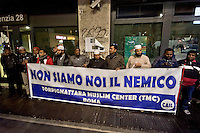 Roma 11 Dicembre 2015<br /> Manifestazione al quartiere multietnico di Tor Pignattara di immigrati,  italiani, musulmani, cristiani, induisti per la pace e la solidariet&agrave; tra i popoli contro il razzismo &egrave; l'integralismo.<br /> Rome December 11, 2015<br /> Demostration at the multi-ethnic neighborhood Tor Pignattara of immigrants, Italians, Muslims, Christians, Hindus for peace and solidarity among peoples against racism is fundamentalism. In the banner reads: We are not the enemy