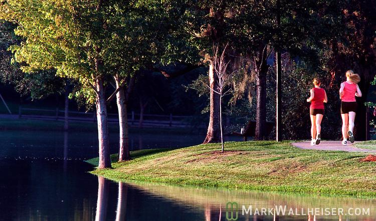 Joggers at Lake Ella in downtown Tallahassee, Florida August 5, 1998.    (Mark Wallheiser/TallahasseeStock.com)