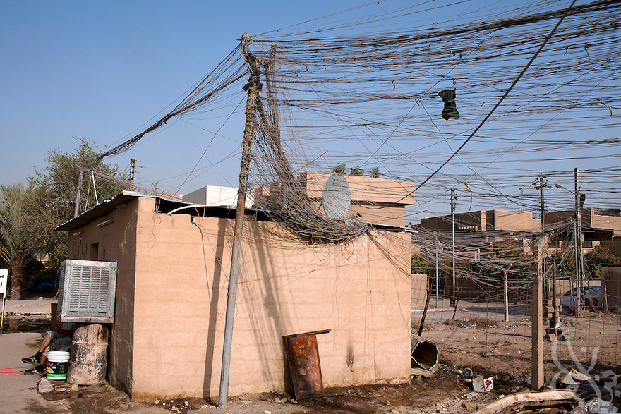 A tangle of hundreds of home-rigged electrical wires are seen extending from a neighborhood generator on a Baghdad street August 23, 2010.  After seven years of conflict, Iraqis still rely heavily on the use of neighborhood or private generators as the iraqi civil electrical grid has struggled to keep pace with demand despite numerous projects to rebuild Iraq's infrastructure and electrical capacity.  .