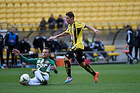 Nathan Burns and Andrew Hoole in action during the A League - Wellington Phoenix v Newcastle Jets Game at Westpac Stadium, Wellington, New Zealand on Sunday 26 October 2014. <br /> Photo by Masanori Udagawa. <br /> www.photowellington.photoshelter.com.