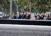 On the 10th anniversary of the September 11th attacks, former First Lady Laura Bush, former president George W. Bush, First Lady Michelle Obama and President Obama pause for a moment of reflection with family members of victims at the North Pool at the September 11th Memorial at the World Trade Center site in New York, New York on September 11, 2011..Credit: Jefferson Siegel / Pool via CNP