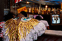Carnival, Rio de Janeiro, Brazil. Preparation for Samba Schools Parade. Couple in love wearing costumes in a bar near Sambodromo waiting to participate in the Samba Schools Parade.
