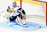 14 December 2009: Buffalo Sabres' goaltender Ryan Miller makes a second period save against the Montreal Canadiens at the Bell Centre in Montreal, Quebec, Canada. The Sabres defeated the Canadiens 4-3. Mandatory Credit: Ed Wolfstein Photo