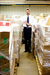 Thomas Hodges stands with hundreds of pounds of used fluorescent bulbs ready to be shipped out for recycling in the hazardous waste storage facility at Auburn University in Auburn, Alabama November 18, 2009. Hodges leads the hazardous materials program.