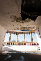 "A damaged entryway inside the New York State Pavilion from the 1964-65 World's Fair in Flushing Meadows Park in Queens in New York on Saturday, February 22, 2014.  The landmarked ""ruin"" designed by the noted architect Philip Johnson has fallen into disrepair over the years. The NYC Dept. of Parks and Recreation estimated that it would costs $72 million to fully restore it, preserving it as a ""ruin"" but stabilized would run $50 million and demolition would only cost $14 million. A number of elected officials and preservationists are working toward preservation of the historic structure. This year is the 50th anniversary of the World's Fair. (© Richard B. Levine)"