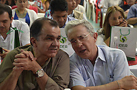 """TAMESIS, CO JULY 24: Colombian former president, opposition senator Alvaro Uribe (R) speaks with Former presidential candidate Oscar Iván Zuluaga (L) during """"Encuentro de Dirigentes del Suroeste"""" in Tamesis Antioquia on July 24, 2016.(Photo by VIEWpress/Guillermo Betancur)"""