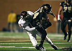 18 November 2006: Virginia Tech's Roland Minor (15) tackles Wake Forest's Kevin Marion (14). The Virginia Tech Hokies defeated the Wake Forest University Demon Deacons 27-6 at Groves Stadium in Winston-Salem, North Carolina in an Atlantic Coast Conference NCAA Division I College Football game.