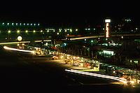 DAYTONA BEACH, FL - FEBRUARY 1: A time-exposure photo illustrating streaks of headlights as cars enter and exit the pit lane during the 1987 24 Hours of Daytona at the Daytona International Speedway in Daytona Beach, Florida, on February 1, 1987.