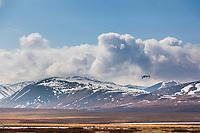 Bush plane flies over the mountains of Gates of the Arctic National Park, Brooks range, Alaska.