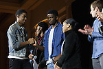 """Mateo Dillard, a business pre-law student, shakes hands with De'Vaughn Williams, a communication studies and music production student, after his singing quartet won the  Black Student Cultural Programming Board's talent showcase """"Apollo Night's Best"""" on Friday, Feb. 5, 2016. Photo by Kaitlin Owens"""